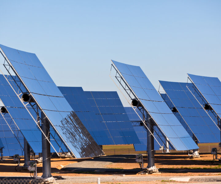 Solar panels on bright blue sky background