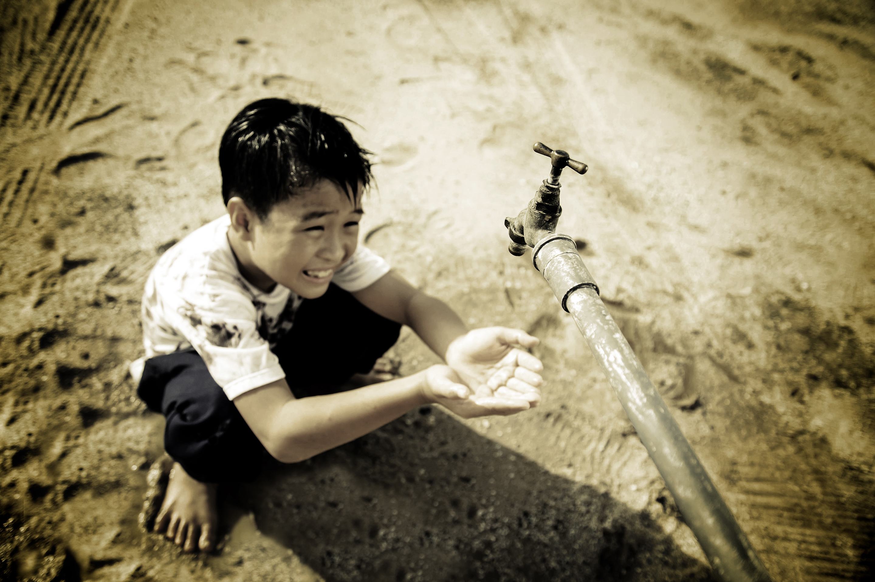 A Young Child Left Pleading for Water